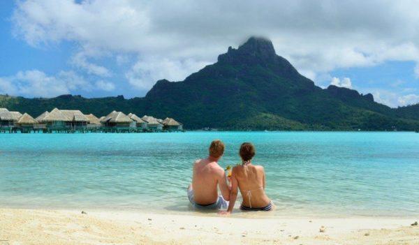 honeymooners on beach in Bora Bora