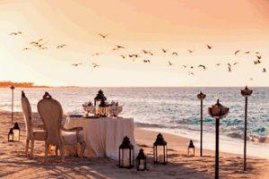 sunset honeymoon dinner on bahamas beach