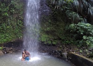 honeymooners at a waterfall in st lucia