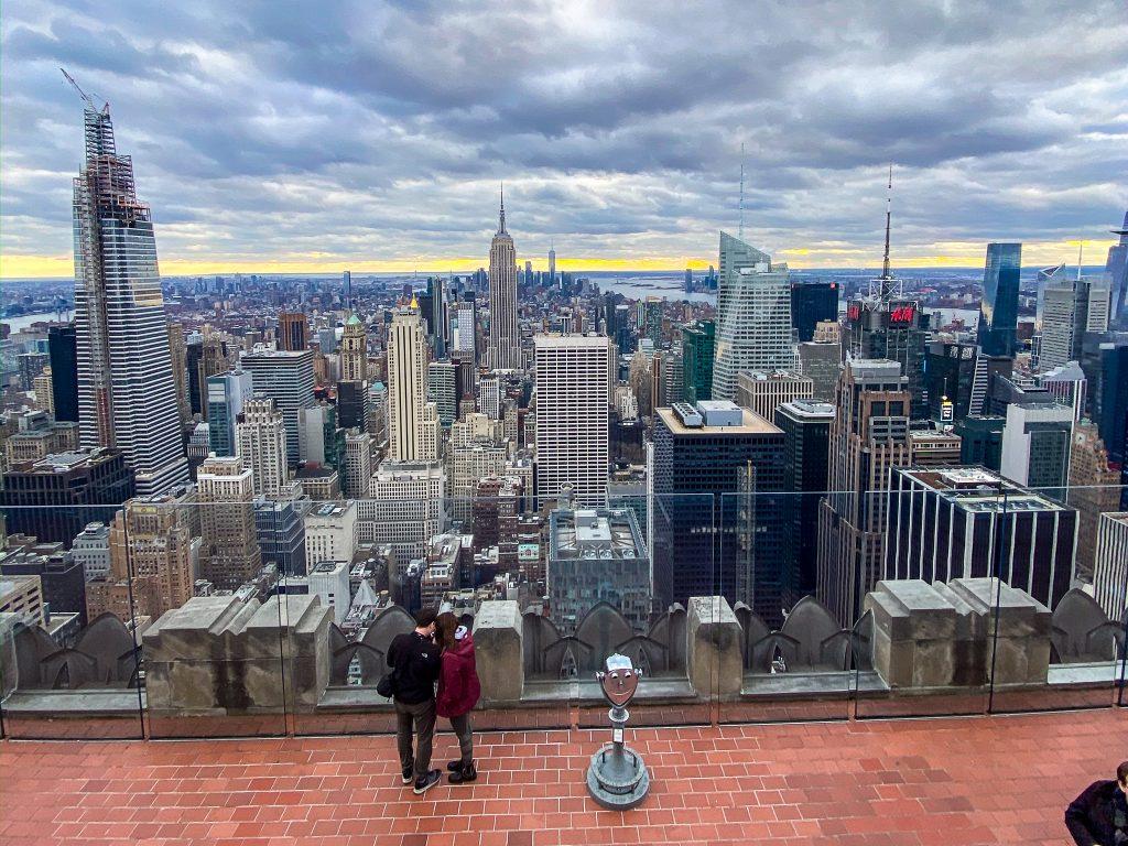 couple on top of Rockefeller Building