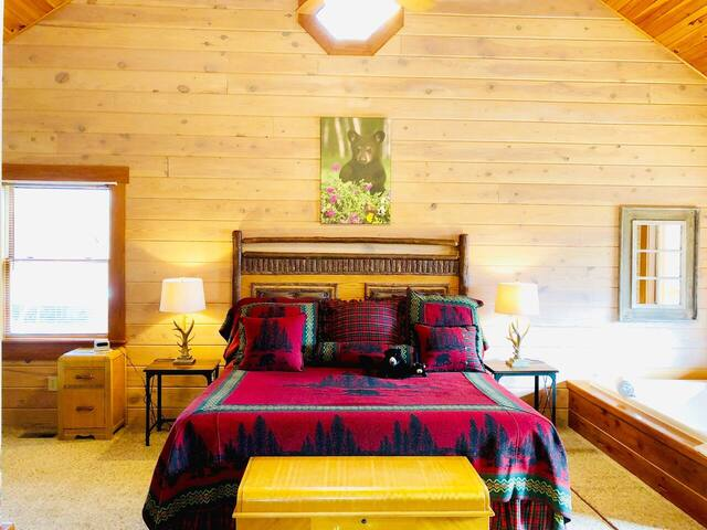 bedroom in romantic cabin with jacuzzi tub