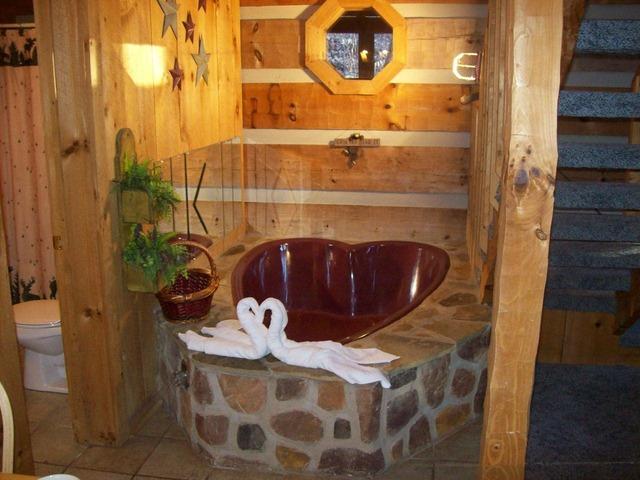 heart shaped jacuzzi in hillbilly hideaway cabin