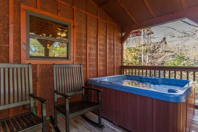 back porch of cabin with hot tub in Pigeon Forge