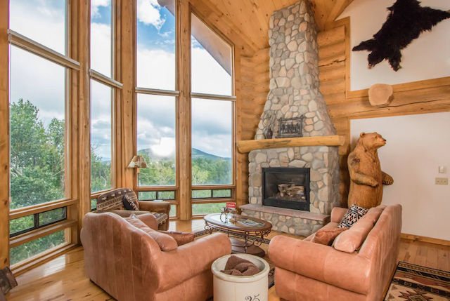 Cabin living room with large windows and a view