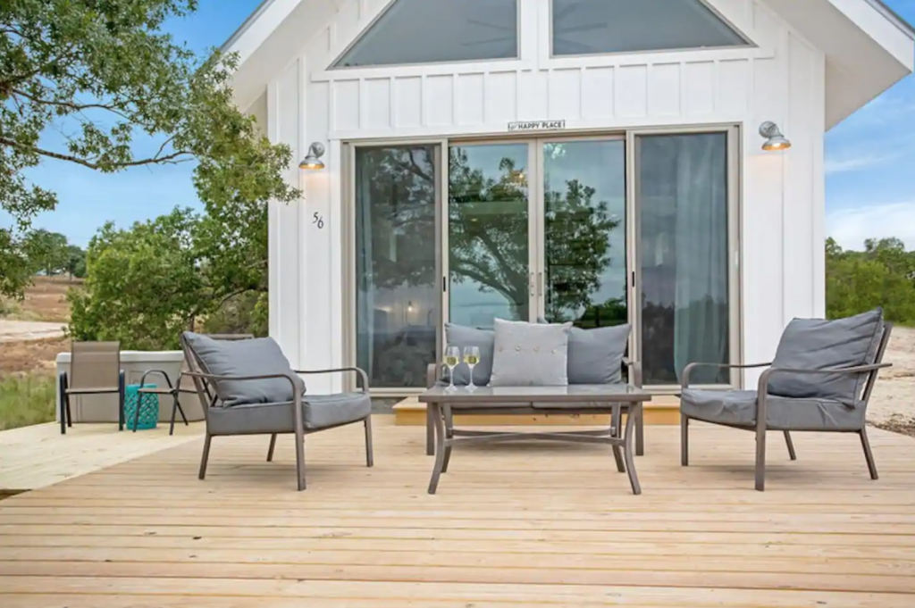 Back porch of cabin with seating area
